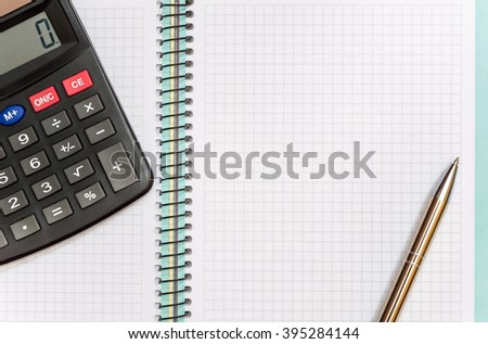 Pen with calculator on notepad