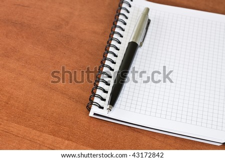 pen with clear notebook laying on the table