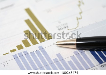 Pen with graphs and stats - stock photo