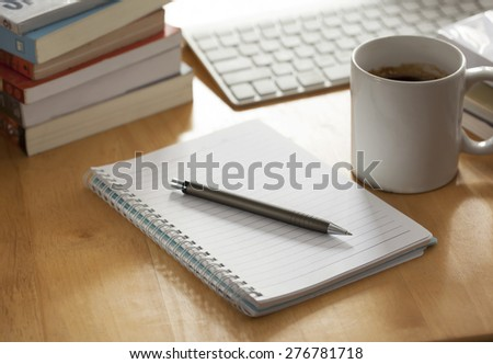 pen with notebook on working table - stock photo