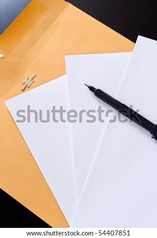 Pen with Paper and Manila Envelope - stock photo