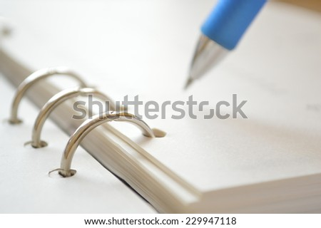 pen with the daily business planner - stock photo