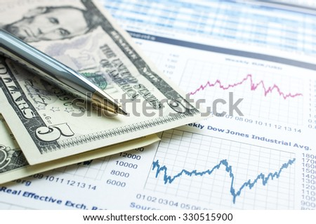 Pen with US Dollar Bank Note on Financial Graph Stock Analysis