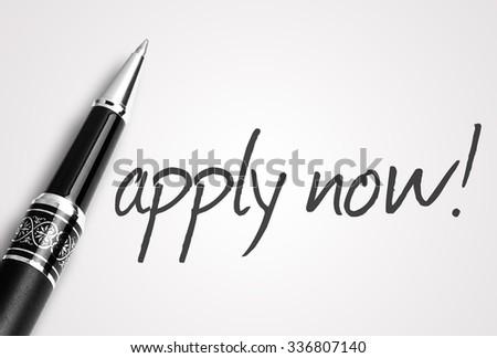 pen writes apply now! on white blank paper. - stock photo