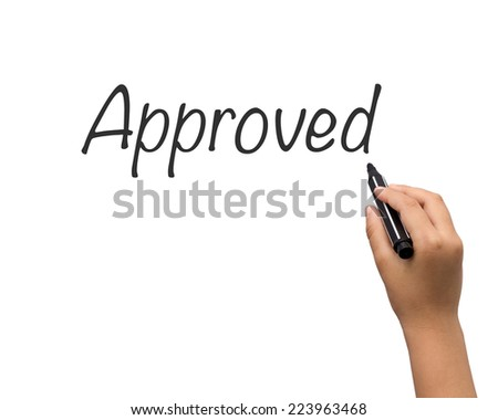 Pen writes approved on paper - stock photo