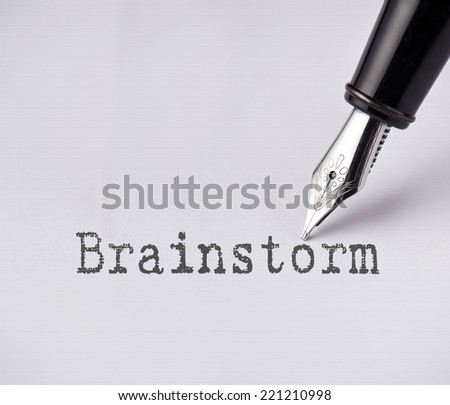 Pen writes brainstorm on paper  - stock photo