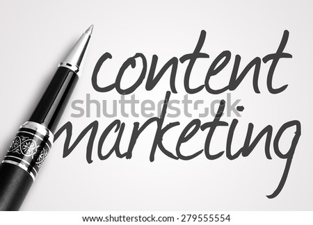 pen writes content marketing on paper. - stock photo