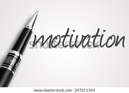 pen writes motivation on paper  - stock photo