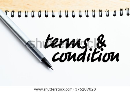 pen writes terms & conditions on paper - stock photo