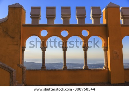 Pena castle yellow arch at sunset in Sintra, Portugal - stock photo