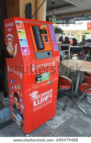Penampang Sabah Malaysia - Jul 30, 2017: A Sunner Wifi hotspot machine beside a restaurant.  The Sunner Wifi Hotspot is a fee-based or free-registration WiFi to provide internet services.
