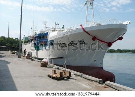 Penang, Malaysia - JAN 25,2013: Tuna Vessel landing at Penang Tuna Port. This vessel catch Tuna in Indian Ocean. Tuna will export to Japan and USA.