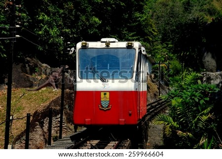 Penang, Malaysia - January 10, 2008:  Funicular Railway car climbs a single track to the summit of 2,730 foot high Penang Hill - stock photo