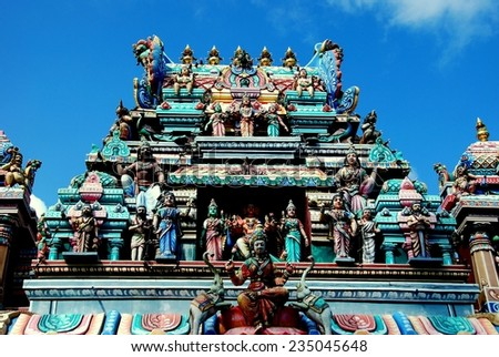 PENANG, MALAYSIA - January 11, 2008:  The remarkable tower with its multiple carved deities and decorations at the Murugan Hindu Temple on the summit of Penang Hill  *