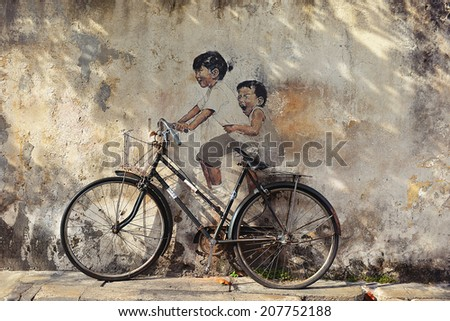 PENANG, MALAYSIA - JUL 18, 2014 : Street Mural entitled 'Little Children on a Bicycle'.  - stock photo