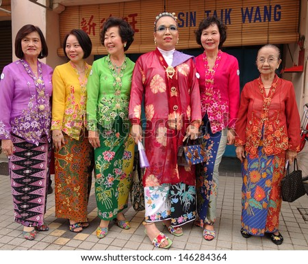 PENANG, MALAYSIA-JULY 6: Women of Nyonya Baba ethnic pose on street during the 5th Anniversary George Town World Site Heritage Celebrations in Penang on July 6, 2013. - stock photo