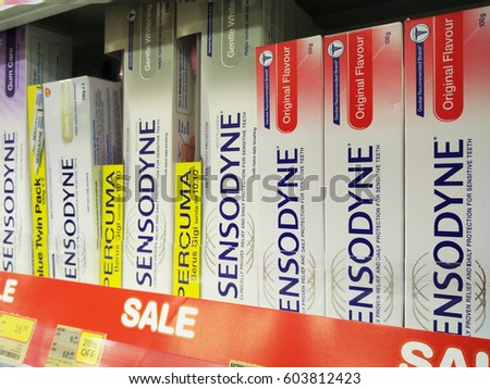 PENANG, MALAYSIA - MARCH 18, 2017: Sensodyne brand toothpaste on the shelves at the oral care department of Cold Storage Supermarket, Sensodyne is a product of GlaxoSmithKline.