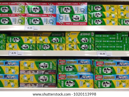 PENANG, MALAYSIA - NOV 16, 2017: Darlie brand toothpaste on store shelves. Darlie, formerly known as Darkie is a famous toothpaste brand with the official Slogan 'Powering Your Smile.'