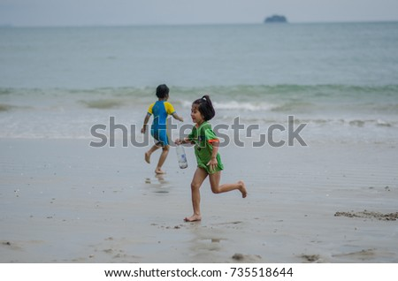 Penang, Malaysia - 17th October 2017 : a child enjoy and swim at the beach