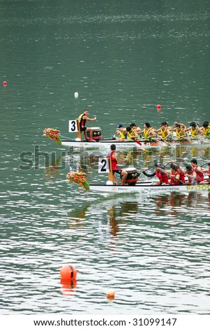 PENANG - MAY 23: Two dragon boats speeding toward the end point at Penang International Dragonboat Festival May 23-24, 2009 in Penang, Malaysia