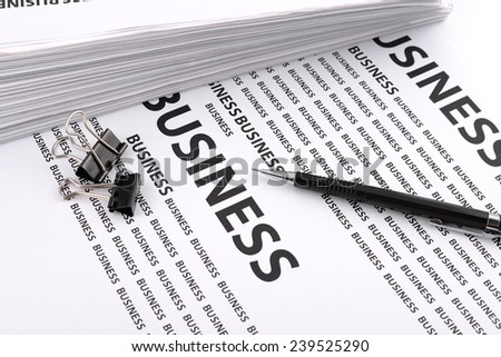 pencil and a file folder with documents on documents business - stock photo