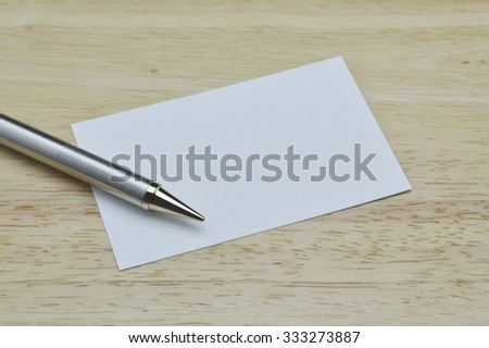 Pencil and blank business card with pencil on wooden office table