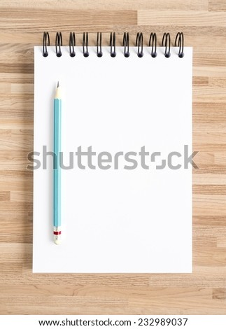 Pencil and blank notebook on wooden texture. Background for painting, drawing and sketching.