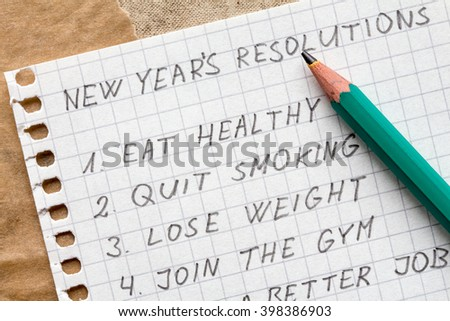 Pencil and list of resolutions for new year