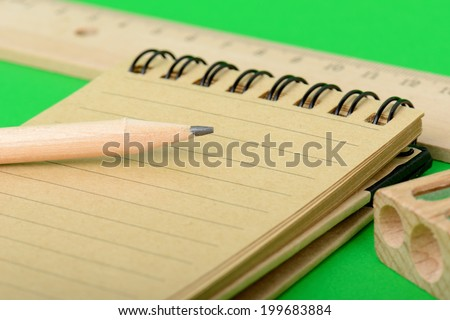 pencil and note pad ready to take notes - stock photo