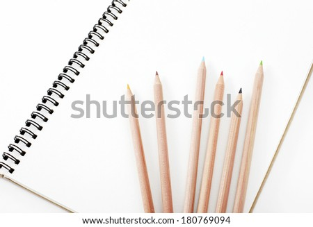 Pencil and notebook - stock photo