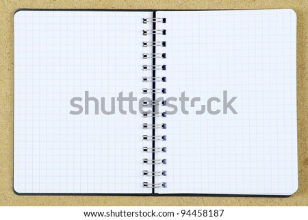 pencil and notebook on woods