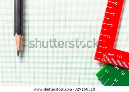 Pencil and Ruler on green graph paper with copy space , Selective focus, Selective focus - stock photo