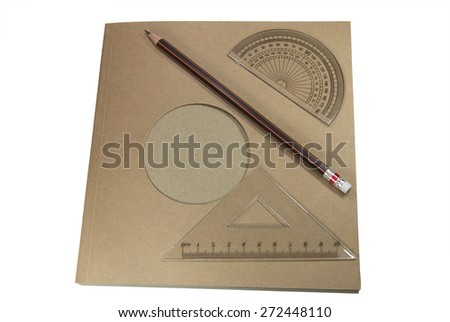 pencil and ruler on recycle paper note book on white background