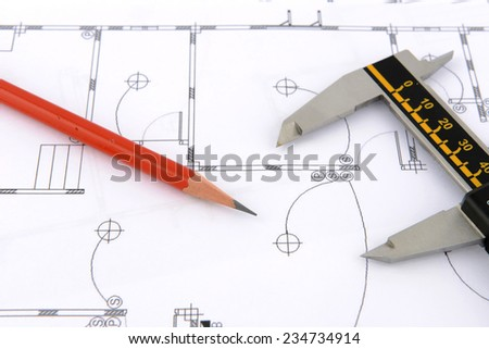 pencil and vernier caliper on plans - stock photo