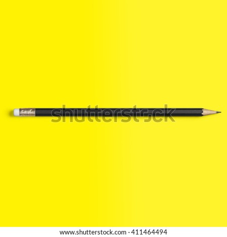 Pencil Black isolated on yellow background - stock photo