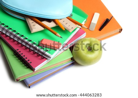 pencil case with notebooks and small accessories on a white isolated background with Apple