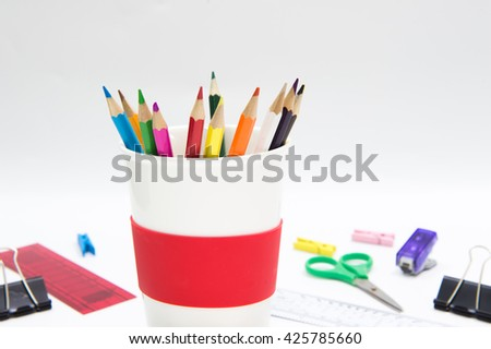 Pencil Crayons in ceramic glass on white background,isolated