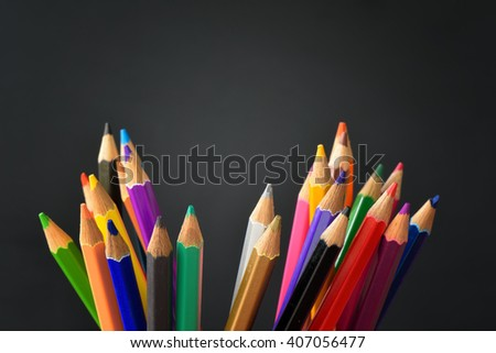 Pencil crayons on black background