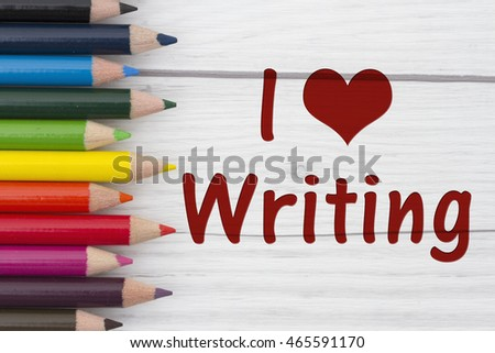 Pencil Crayons with text I love Writing with weathered wood background