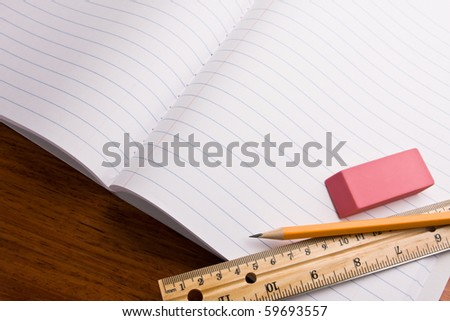 Pencil,eraser and ruler on top of notebook. Concept of back to school. - stock photo