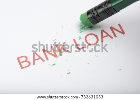 Pencil eraser trying to remove the word 'bank loan' on paper, concept of growing debts or credit, financial problem