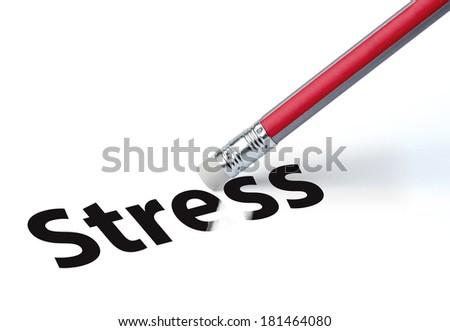 Pencil erasing the word 'stress' - stock photo
