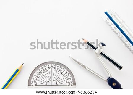 Pencil, Half circle ruler, dividers and ruler as drawing instruments. - stock photo