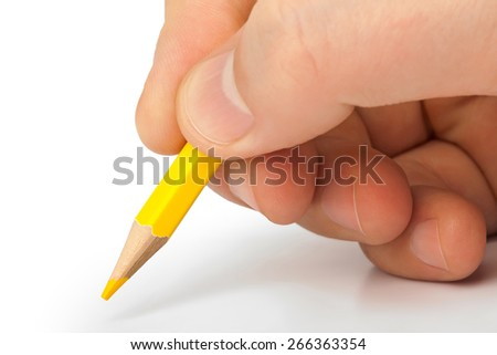 Pencil in hand isolated on white background - stock photo