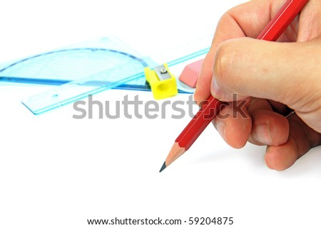 Pencil in male hand and ruler - stock photo