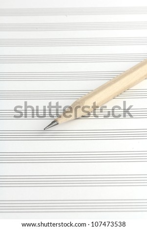 pencil on a blank staff paper - stock photo