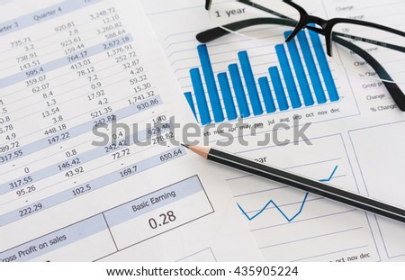 Pencil on business analysis report on desk's executive. Concept of data analytics.