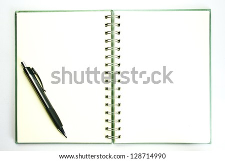 pencil on open  book with empty page
