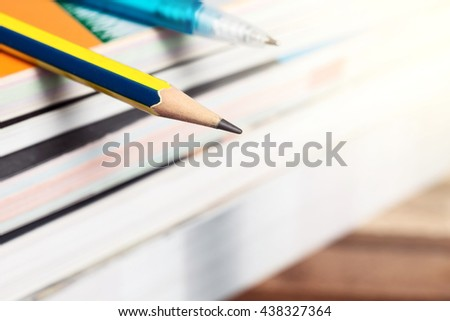 Pencil on stack of books with gradient colour filter effect,School Supplies concept. - stock photo