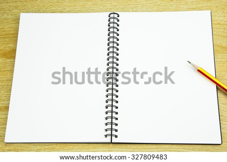 pencil  on the notebook